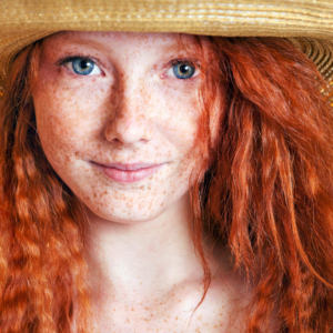 redhead with hat
